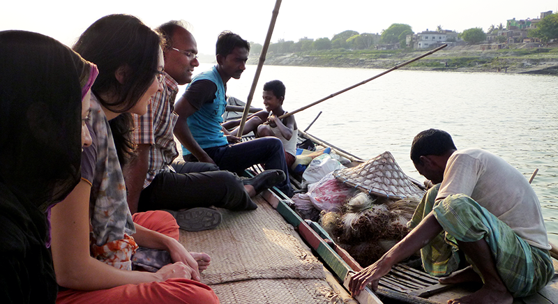 students on boat doing field interviews